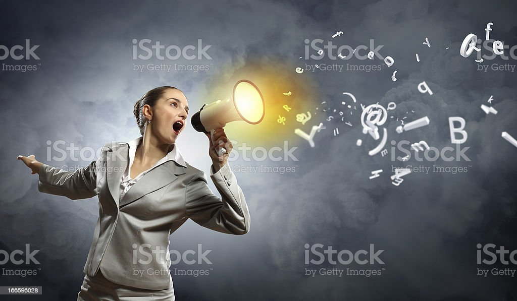 businesswoman with megaphone royalty-free stock photo