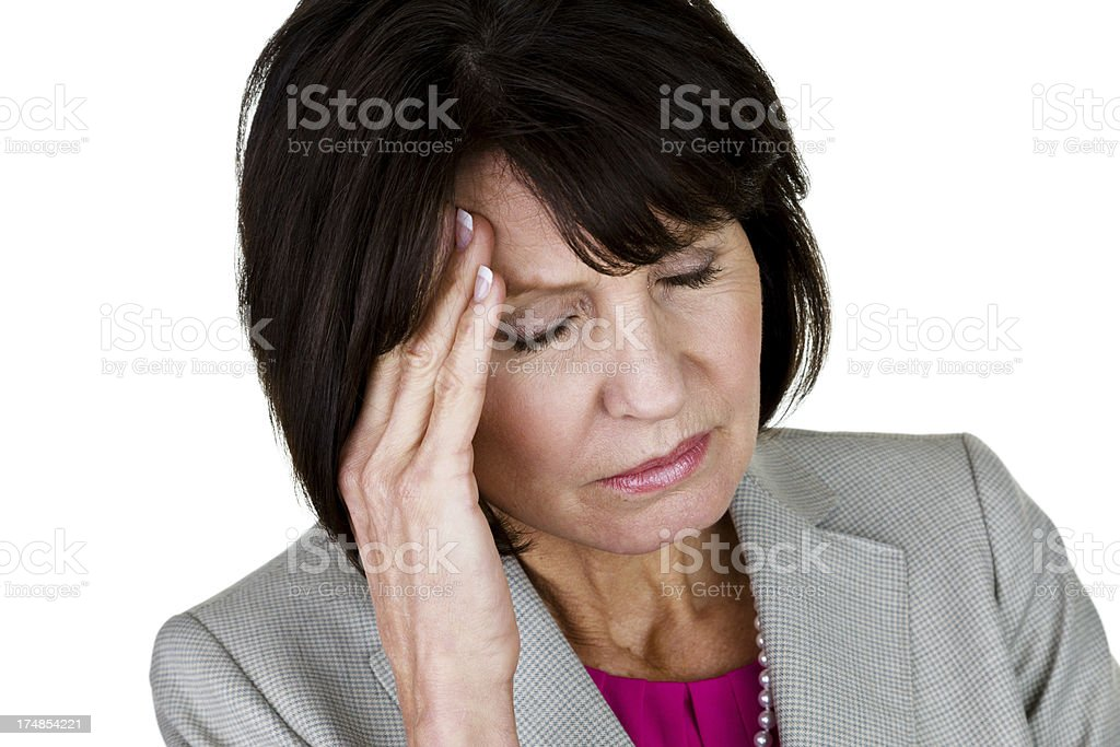 Businesswoman with migraine headache royalty-free stock photo