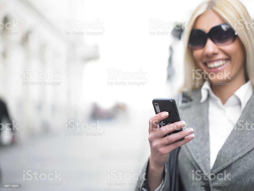 Businesswoman with mobile phone royalty-free stock photo
