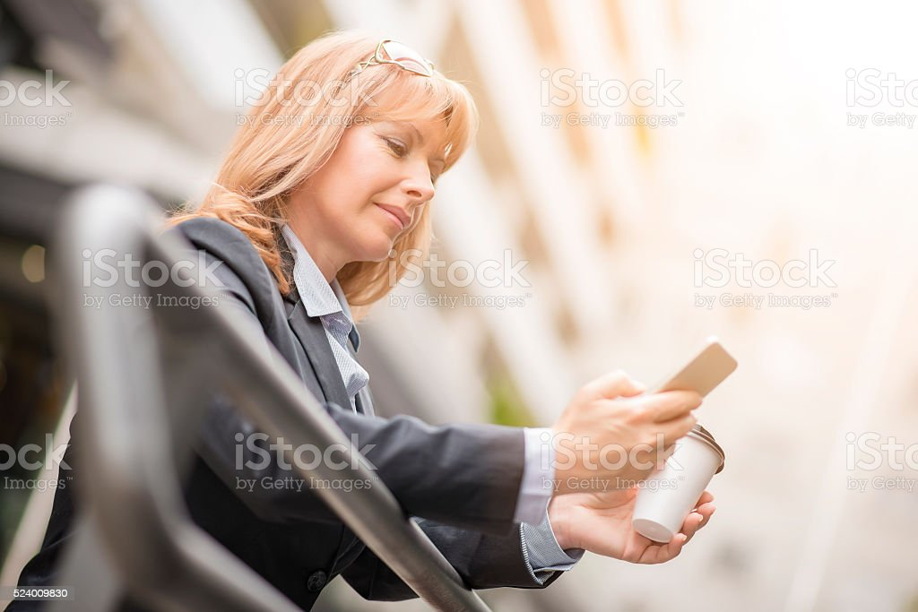 Businesswoman with mobile phone stock photo