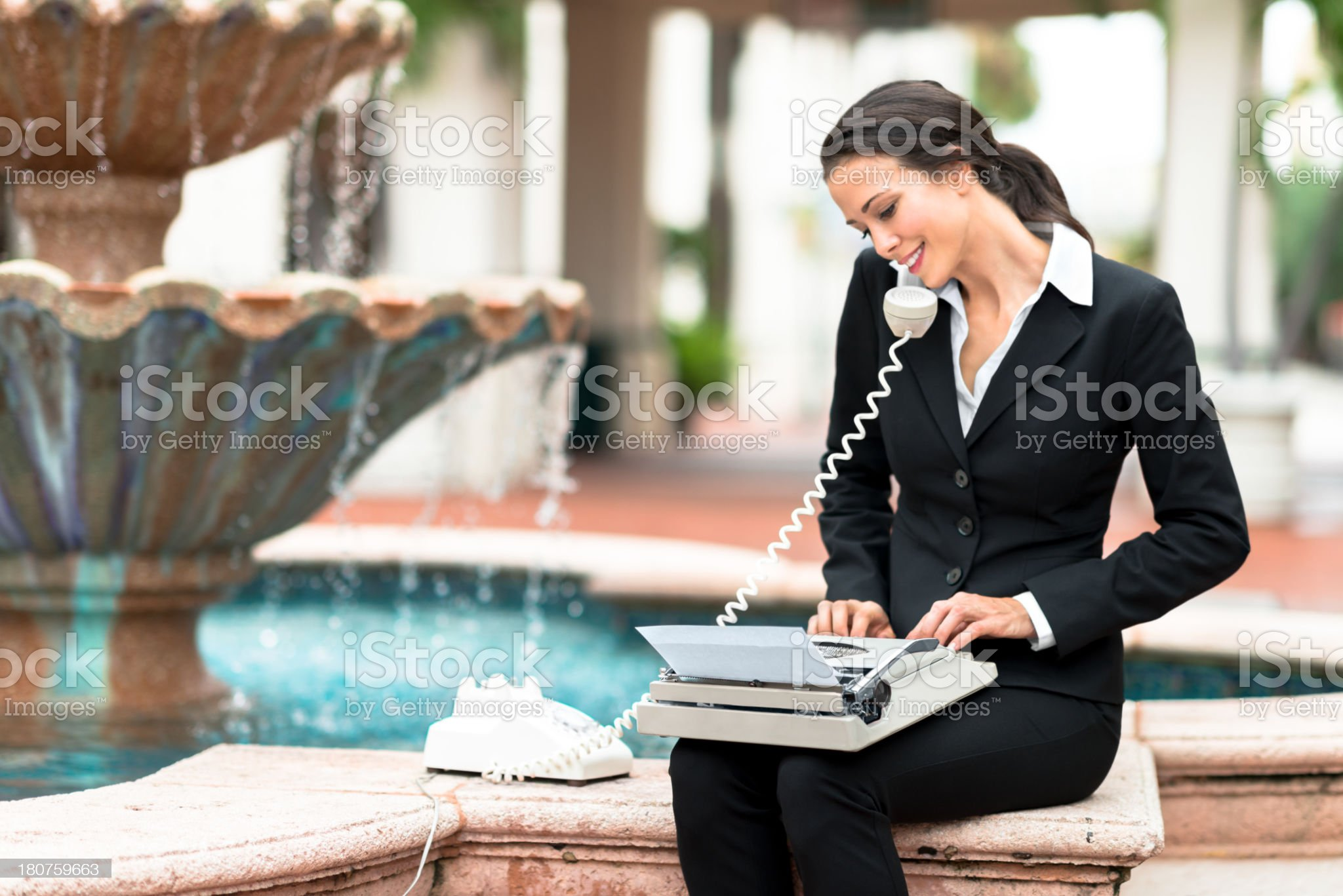 Businesswoman with Old Telephone and Typewriter royalty-free stock photo