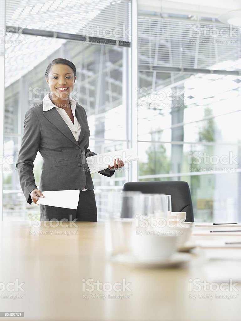 Businesswoman with paperwork in conference room royalty-free stock photo