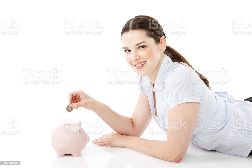 Businesswoman with piggy bank royalty-free stock photo