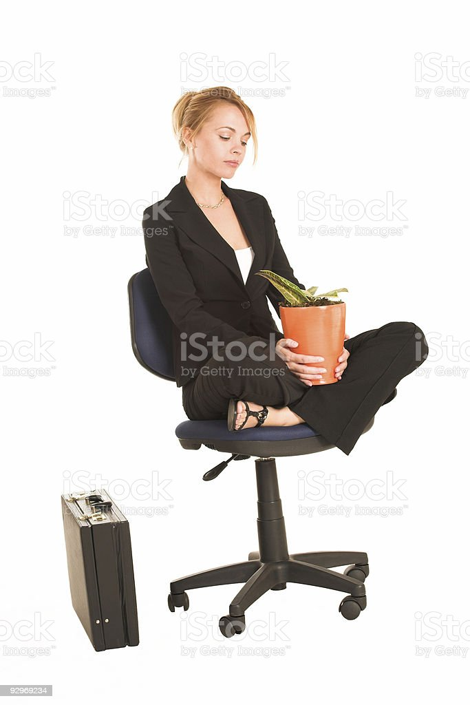 Businesswoman with potplant stock photo