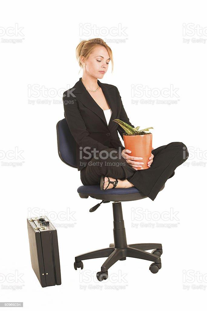 Businesswoman with potplant stock photo