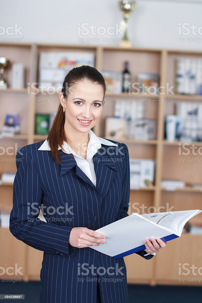 Businesswoman with product catalog royalty-free stock photo