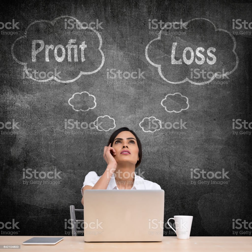 Businesswoman with profit and loss thought bubble stock photo