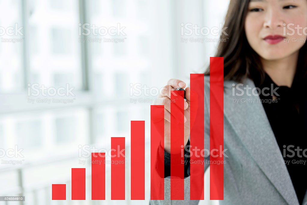 Businesswoman with profit graph stock photo