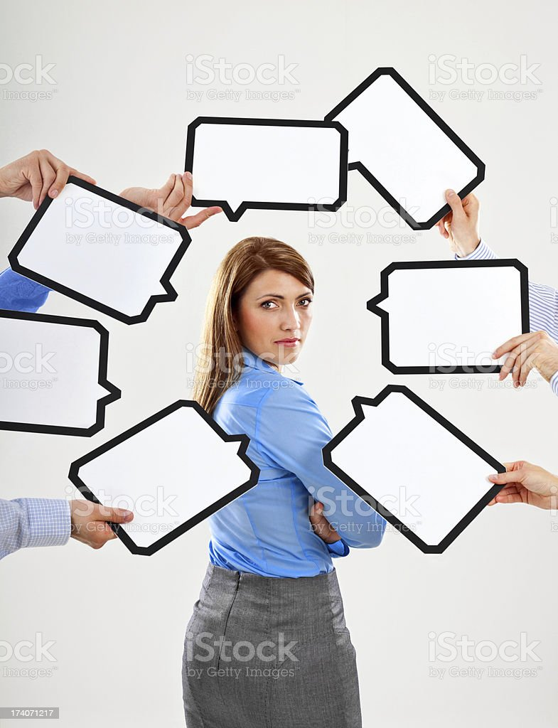 Businesswoman with speech bubbles royalty-free stock photo