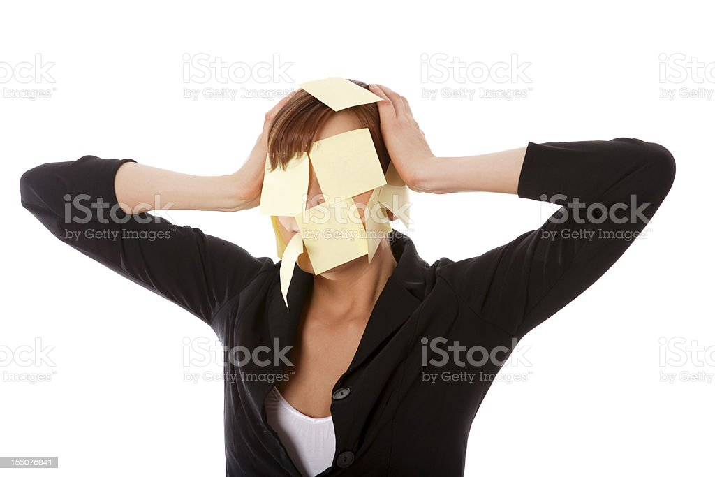 Businesswoman with sticky notes on face royalty-free stock photo
