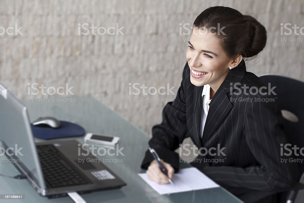 Businesswoman with teeth smile writing royalty-free stock photo