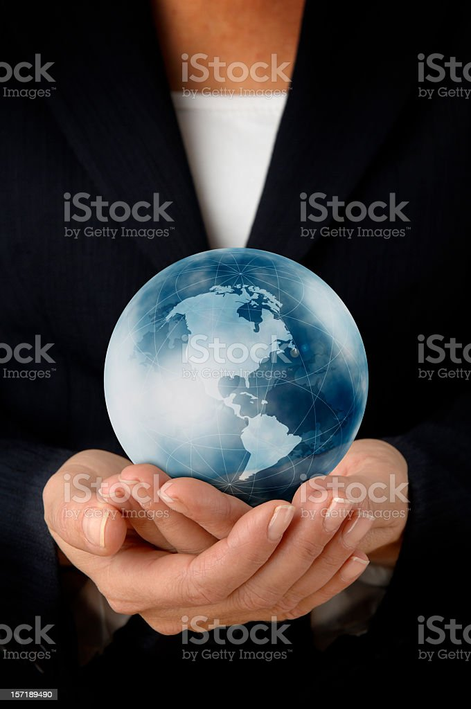 Businesswoman with the world in her hands royalty-free stock photo