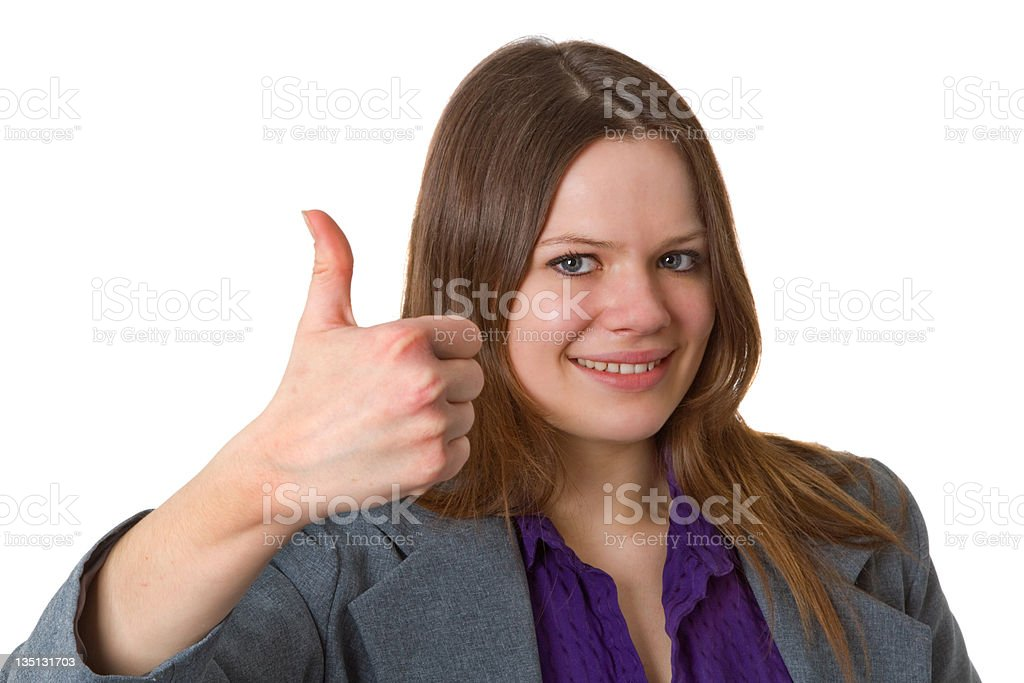 Businesswoman with thumbs up gesture stock photo