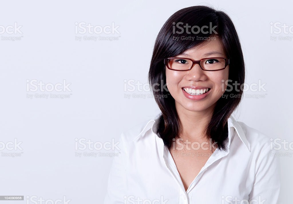 Businesswoman with white shirt smiling on white background royalty-free stock photo