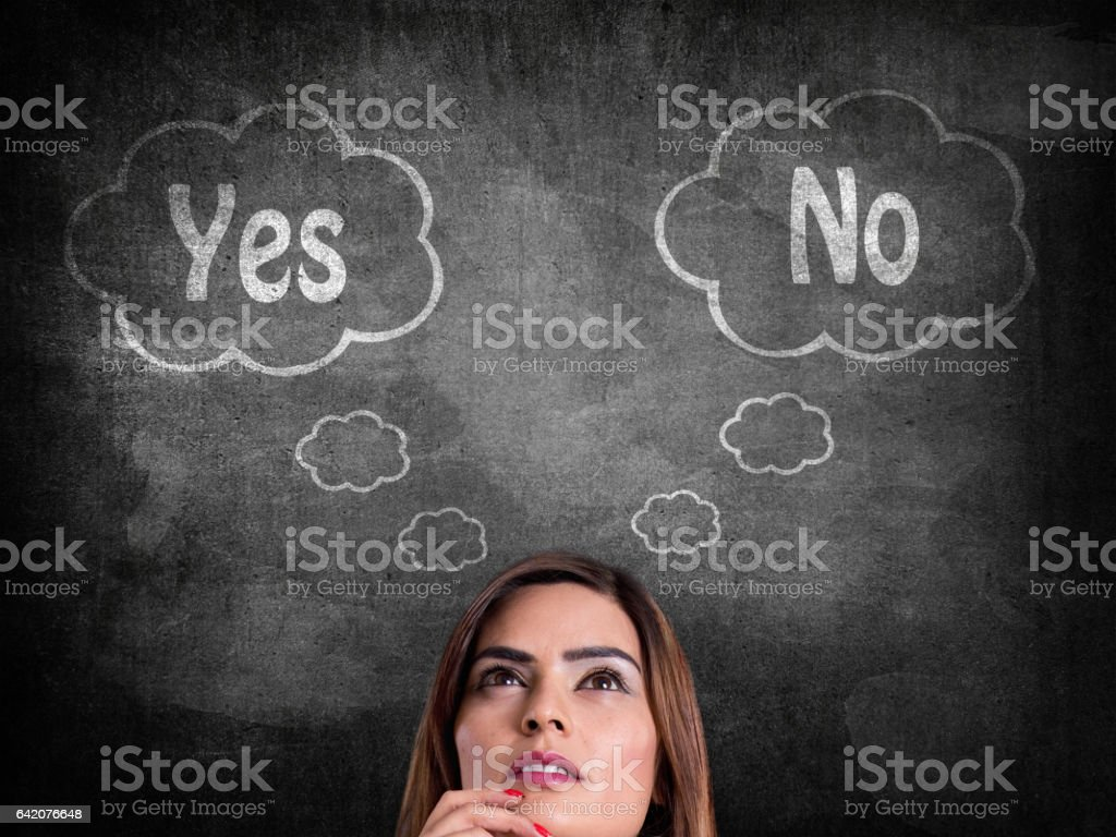 Businesswoman with yes or no choice stock photo