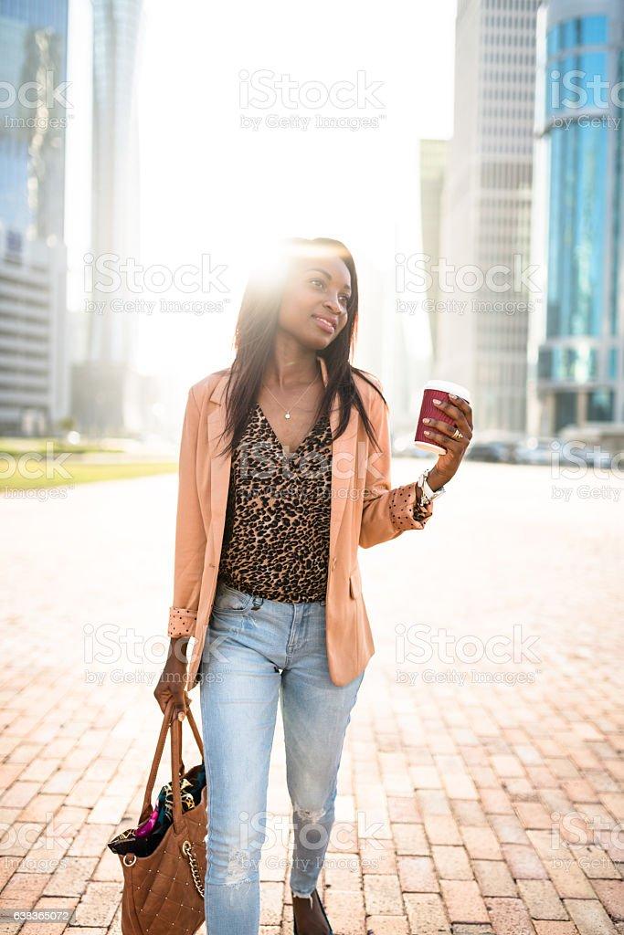 businesswoman woman walking in doha - qatar stock photo