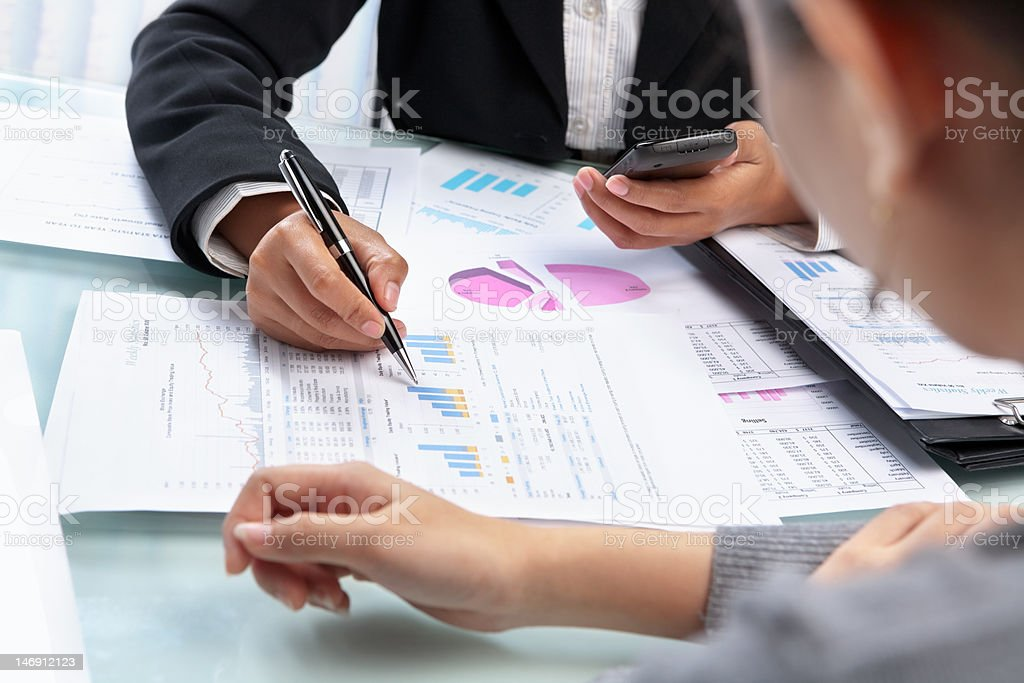 Businesswoman working and analyzing royalty-free stock photo