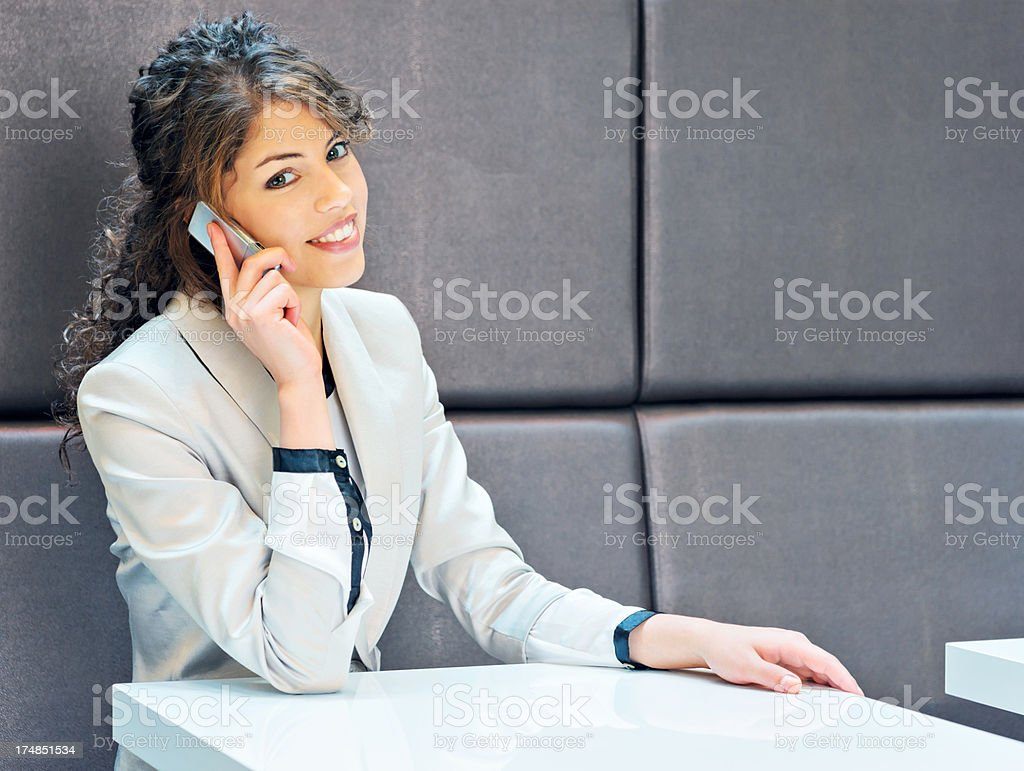 Businesswoman working and communicating on cellphone royalty-free stock photo