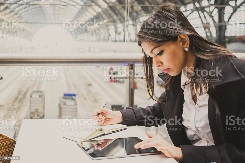 Businesswoman Working At Milan Central Train Station stock photo