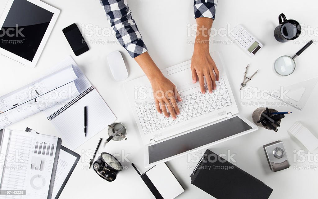 Businesswoman Working At Notebook stock photo