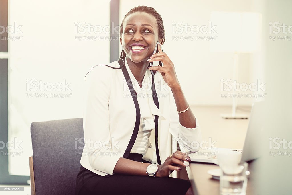 Businesswoman working at the hotel room stock photo