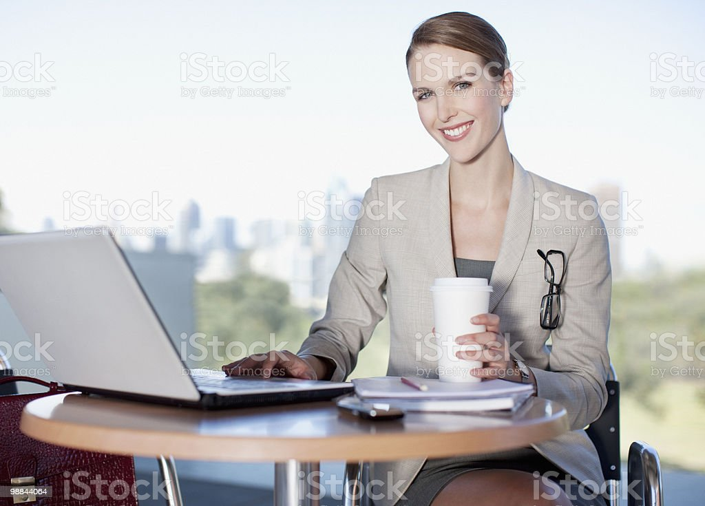 Businesswoman working in cafe stock photo