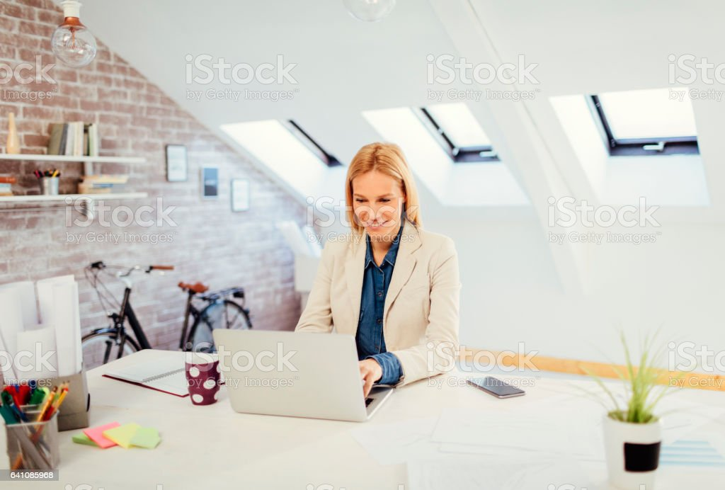 Businesswoman working in her office stock photo