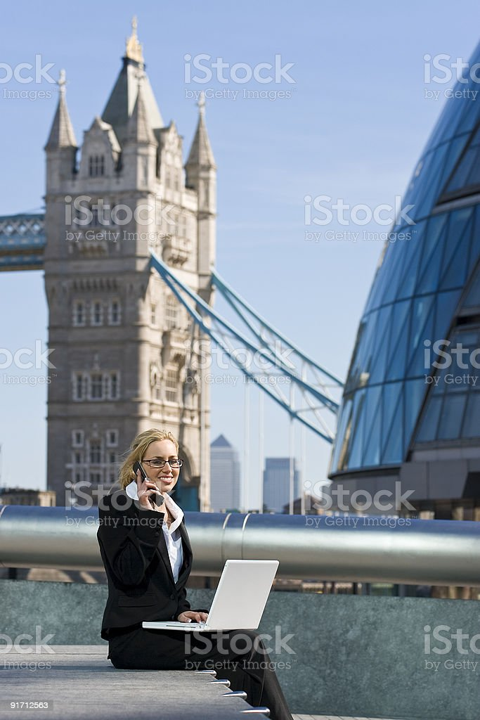 Businesswoman Working In London on a Laptop and Cell Phone royalty-free stock photo