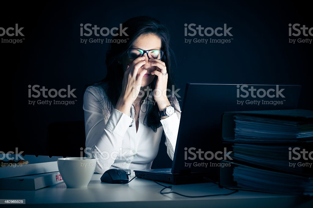 businesswoman working late stock photo