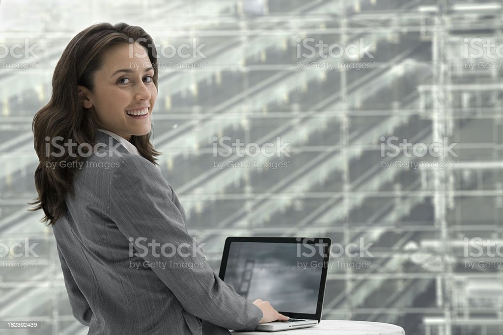 Businesswoman working of a laptop royalty-free stock photo