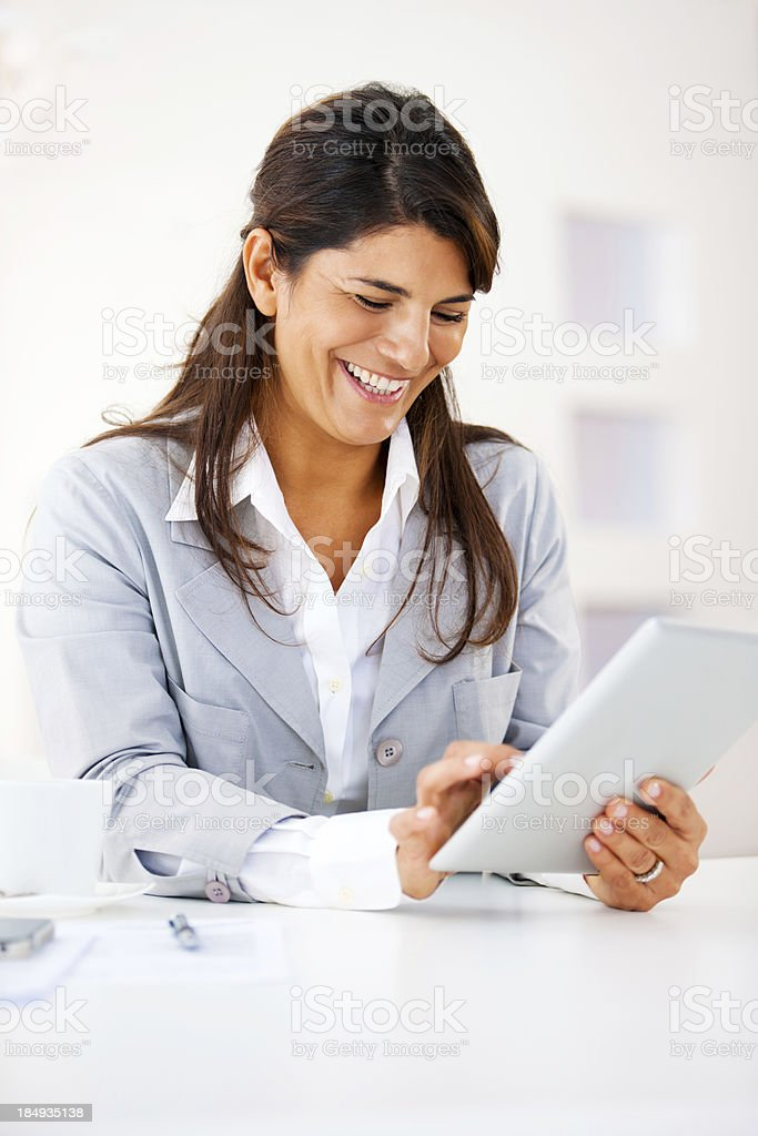 Businesswoman working on a tablet computer royalty-free stock photo