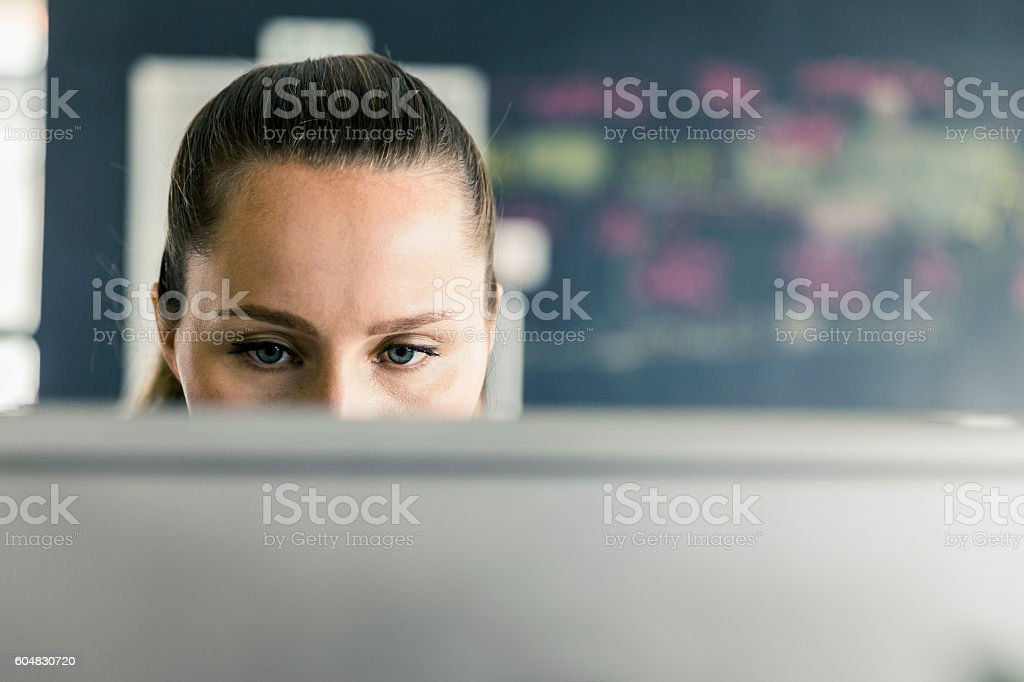 Businesswoman working on computer at office stock photo