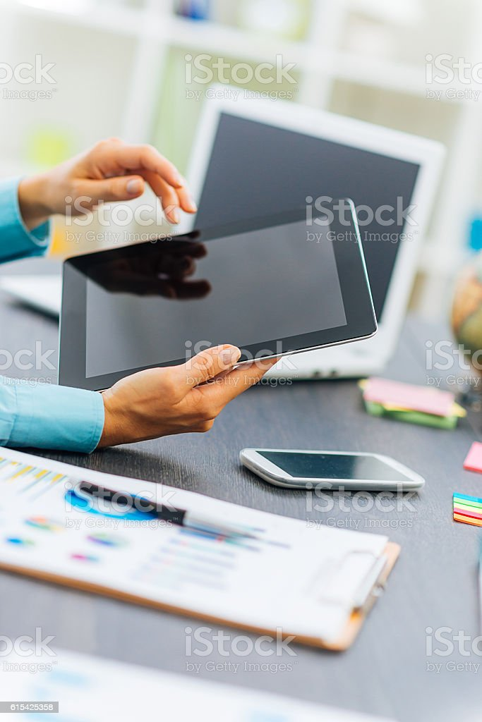 Businesswoman working on computer in office stock photo