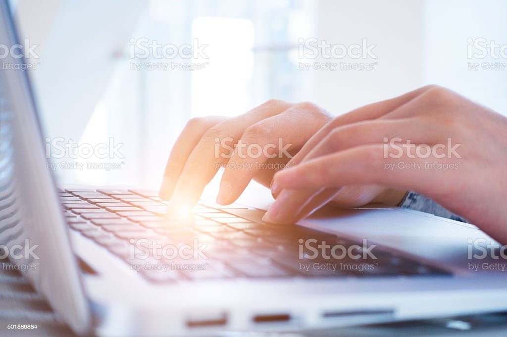 Businesswoman working on desk with laptop stock photo