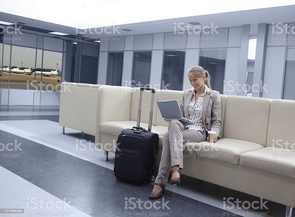 Businesswoman Working on her Notebook  in the Airport. royalty-free stock photo