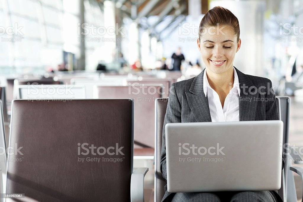 Businesswoman Working On Laptop At Airport royalty-free stock photo