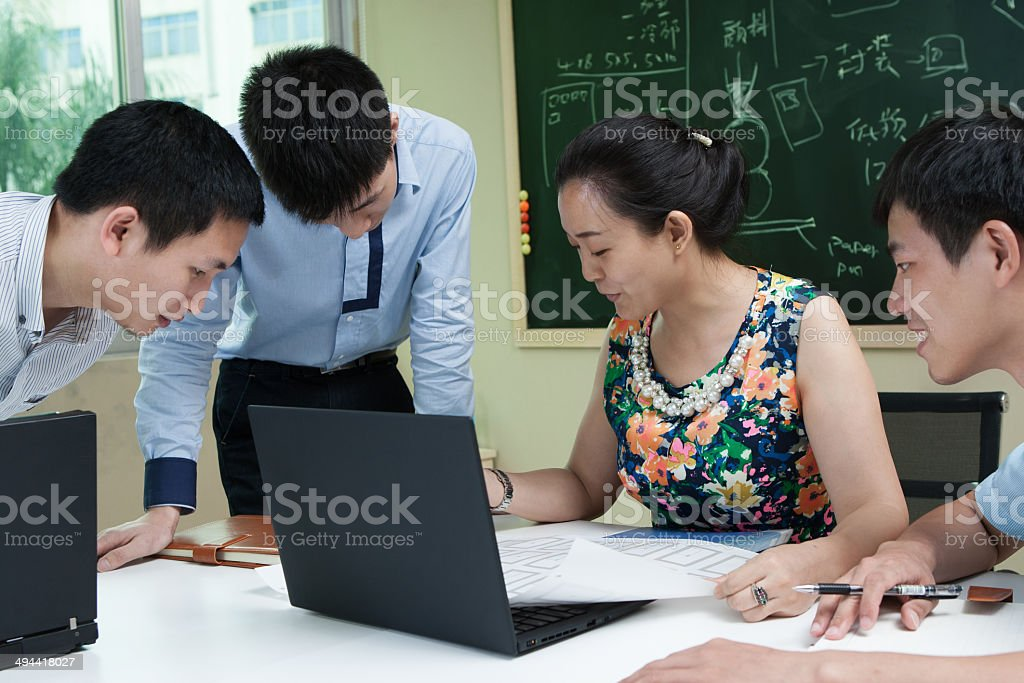 Businesswoman working on laptop in an office stock photo