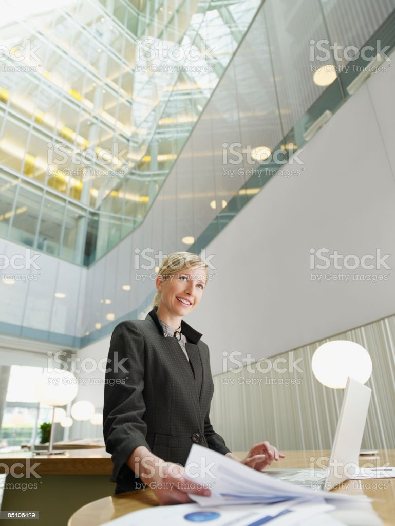 Businesswoman working on laptop in cafe royalty-free stock photo