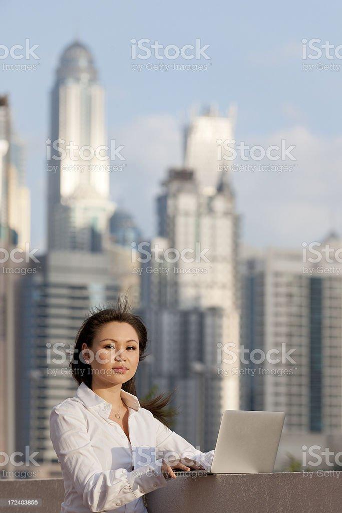 businesswoman working on laptop in Dubai royalty-free stock photo