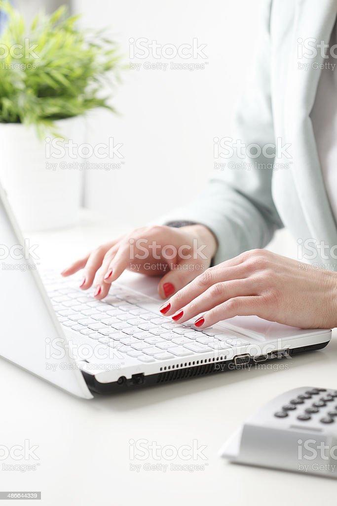 Businesswoman working on laptop. stock photo