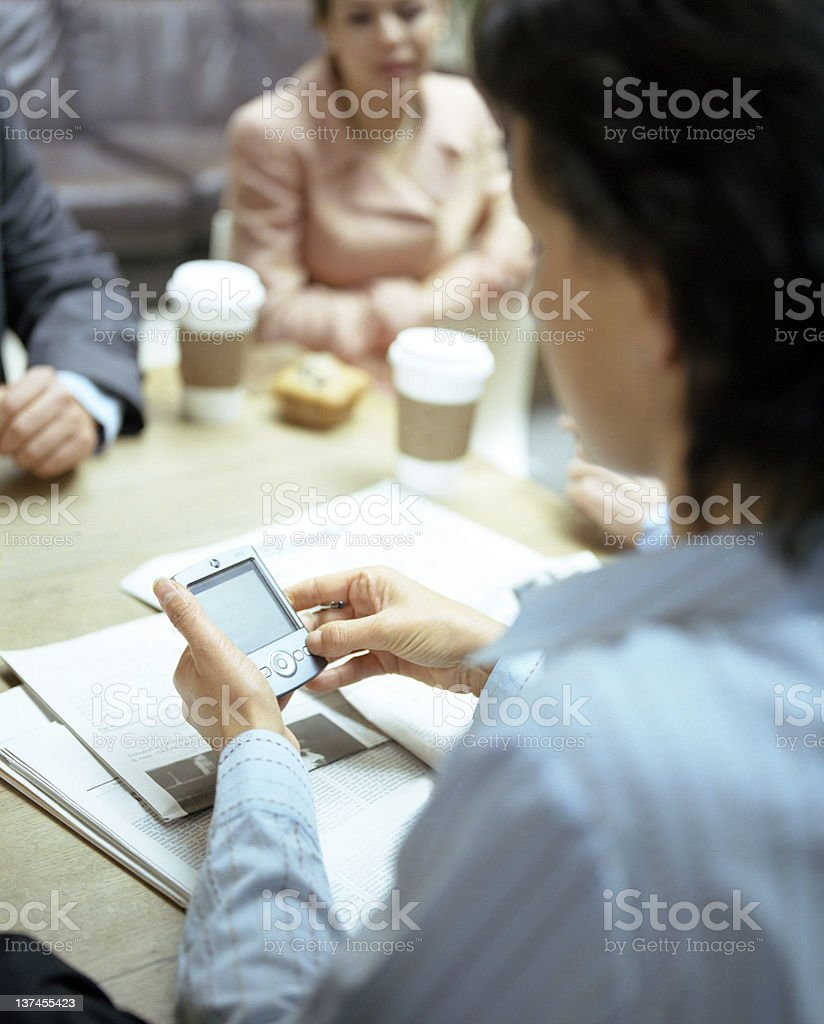 Businesswoman working on smartphone royalty-free stock photo