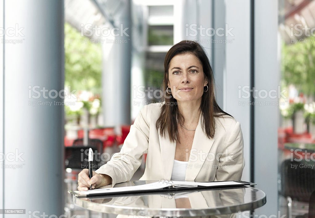 Businesswoman working on terace royalty-free stock photo