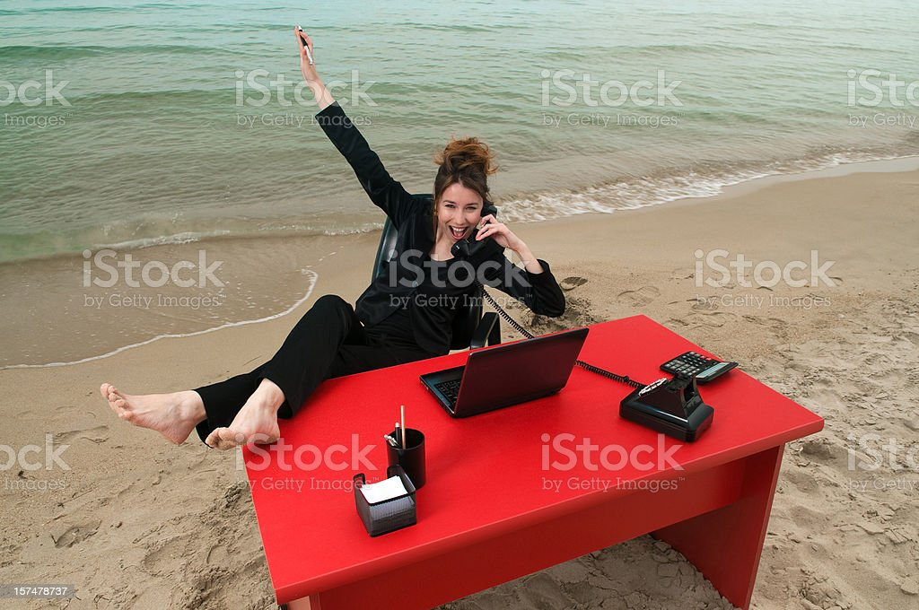 Businesswoman working on the beach royalty-free stock photo