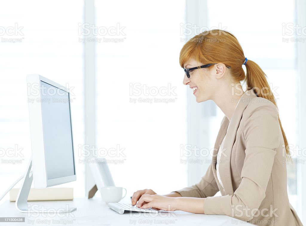 Businesswoman working on the computer royalty-free stock photo