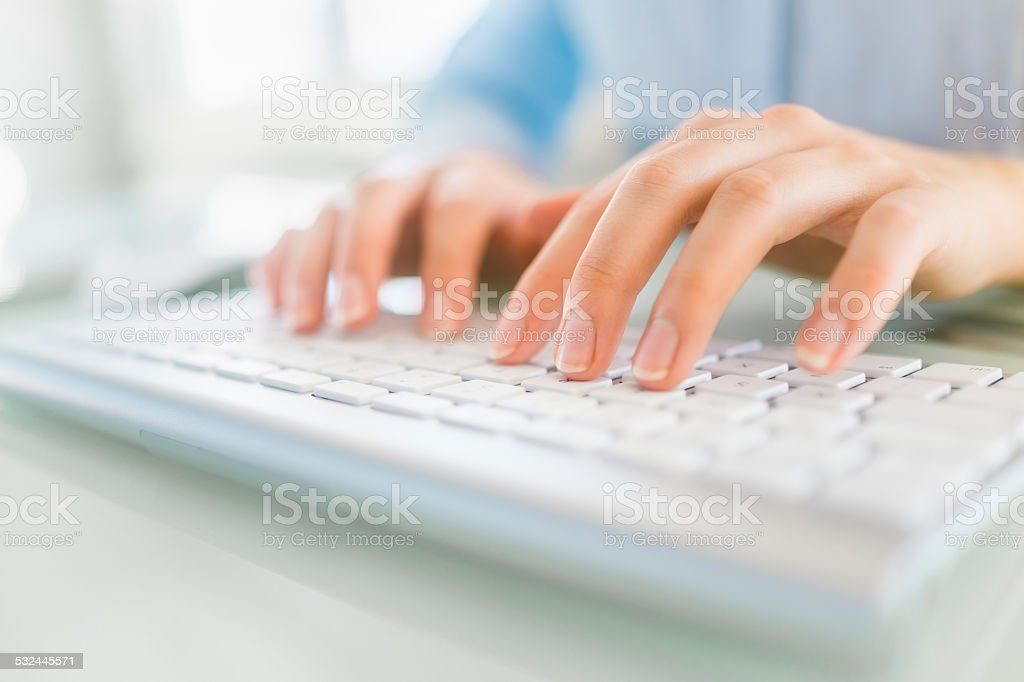 Businesswoman working on the computer stock photo