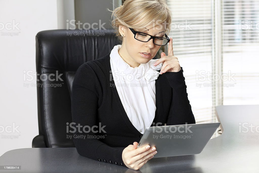 businesswoman working on the tablet royalty-free stock photo