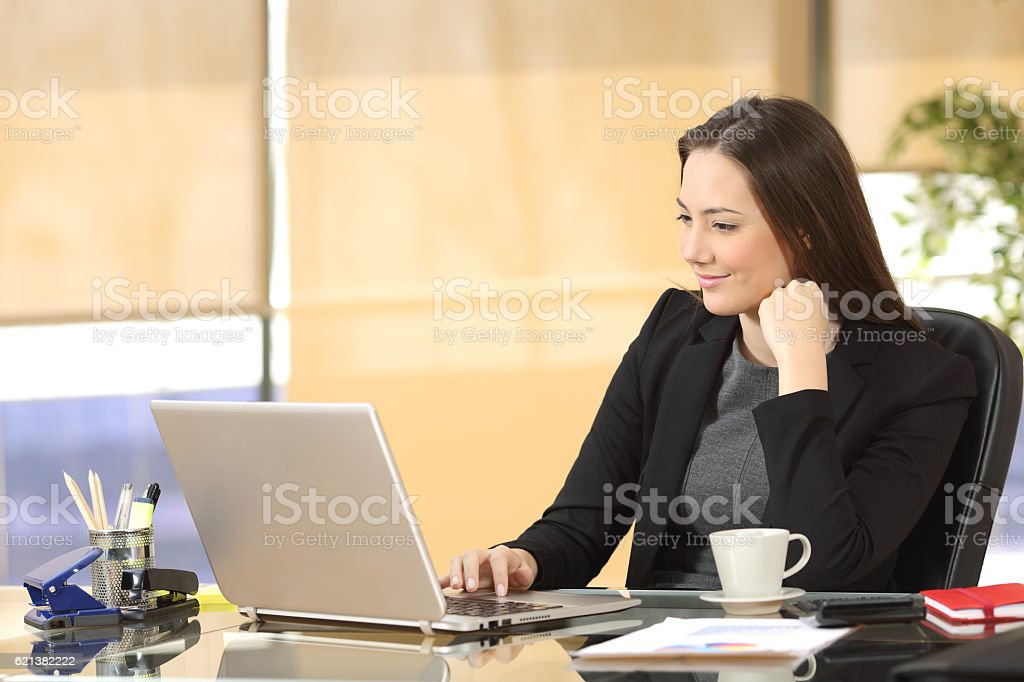 Businesswoman working online at office stock photo