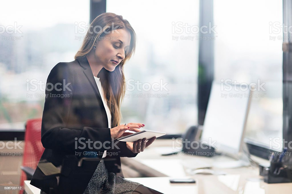 Businesswoman working with a digital tablet stock photo