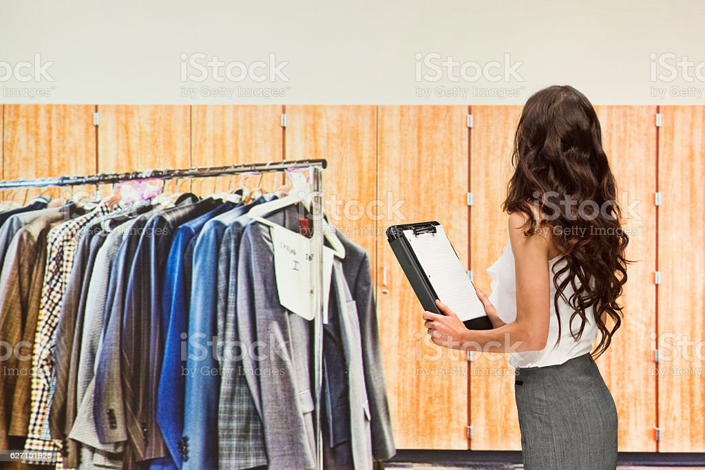 Businesswoman working with clipboard stock photo