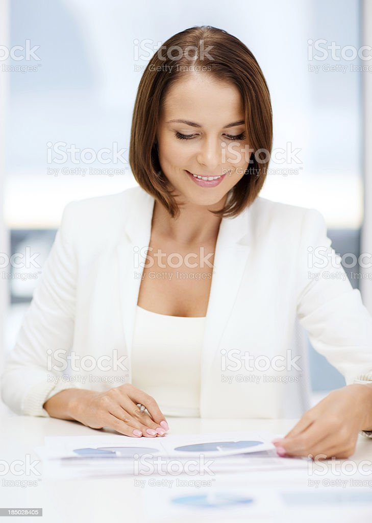 businesswoman working with graphs in office stock photo